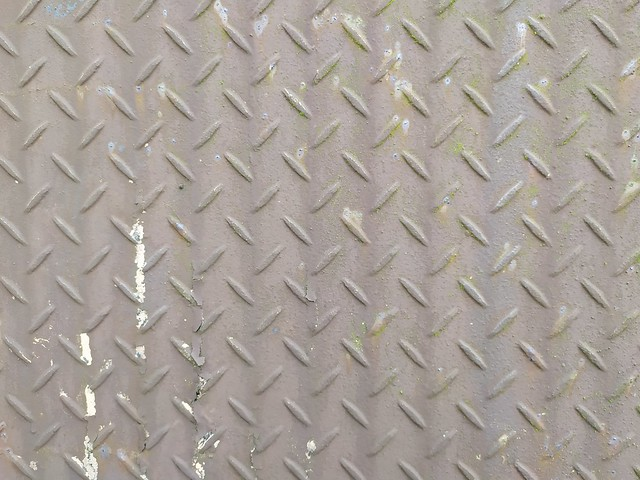 Brown metal texture with cross lines
