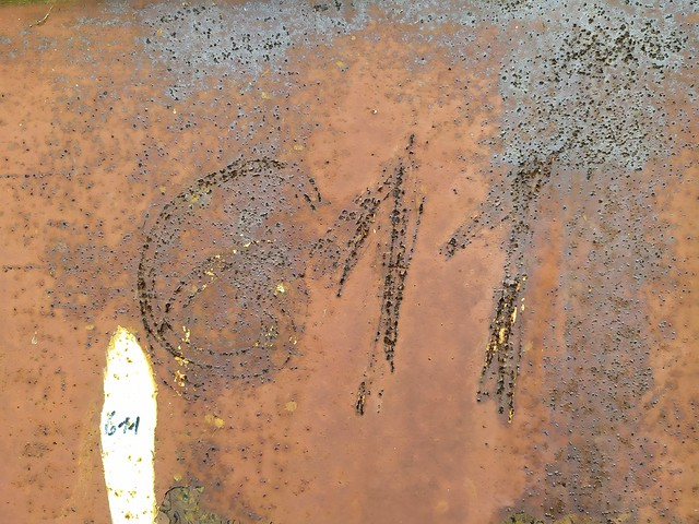 Brown cracked metal surface with 611 number