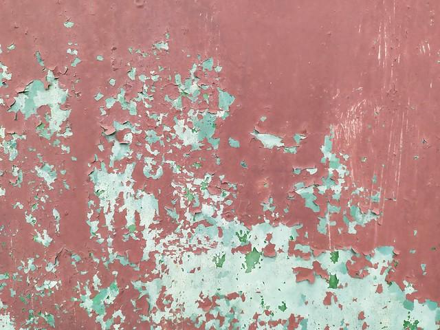 Red, white, green metal texture closeup