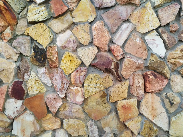 Brown stone wall texture with concrete