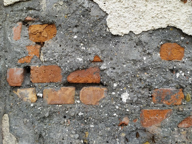 Old brick wall with concrete