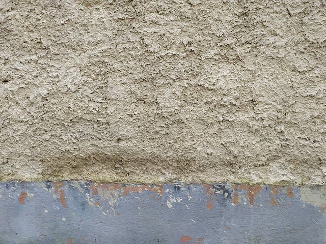 Dirty old brown painted wall with concrete