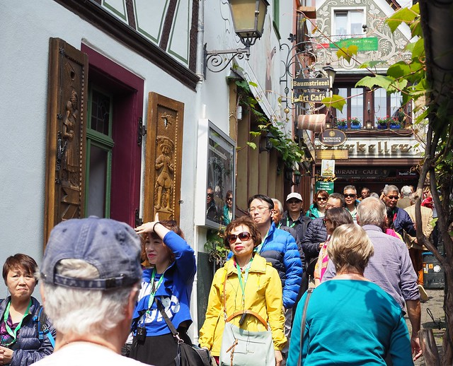 Tourists in Old Town Ruedesheim on the River Rhine in the famous little Street DROSSELGASSE - 2019