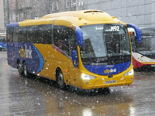 Edinburgh Coach Lines Scania K410EB6 Irizar i6 YR68NMF, in Citylink livery, operating service M92 to dundee departing Edinburgh Bus Station, in a snow shower, on 10 February 2020.