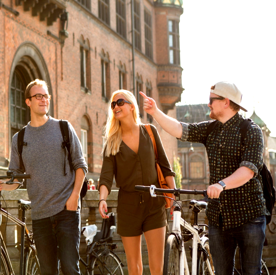 Four students walking through a European city