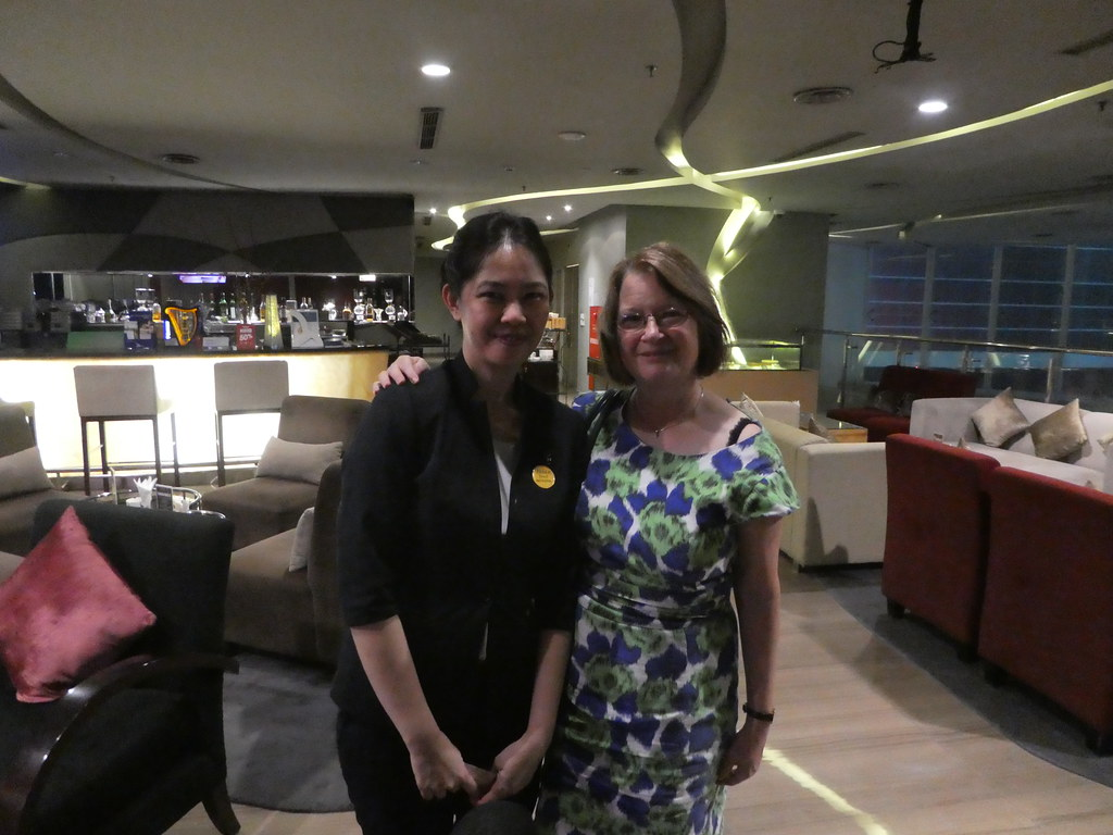 With our friendly waitress at the Novotel, Jakarta