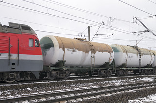 2ES4K DC eloc leads a train of oil tanks from St. Petersburg Sea Port