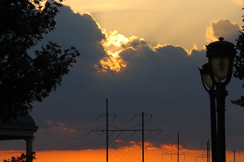 philadelphia pennsylvania sunset red clouds lamp post lamppost sun golden yellow tree wires electricity summer sky