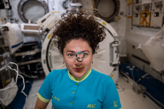 Flight Engineer Jessica Meir observes a floating sphere of water