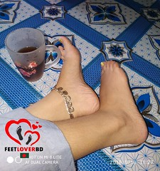 Feet with cup of Tea