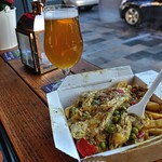 Chicken Curry and Chips with a Lager at Preston Market