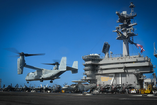 PACIFIC OCEAN (Feb. 15, 2020) An MV-22 Osprey assigned to the Dragons of Marine Medium-Tiltrotor Squadron (VMM) 265, 31st Marine Expeditionary Unit, approaches the flight deck of the aircraft carrier USS Theodore Roosevelt (CVN 71) during operations with the America Expeditionary Strike Group. Operating as an Expeditionary Strike Force, the Navy-Marine Corps team integrates carrier strike group combat power with the flexible capability of an expeditionary strike group to provide the fleet commander with a capable, credible combat force that can be deployed anywhere in the world. (U.S. Navy photo by Mass Communication Specialist 3rd Class Brandon Richardson/Released)
