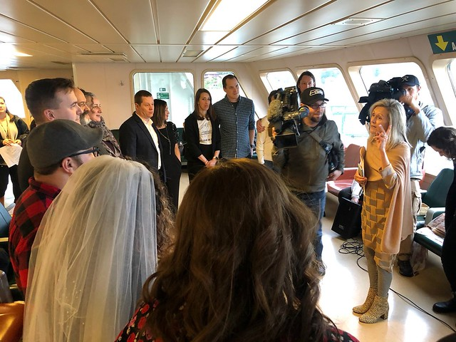 Several couples gather on a ferry to renew their marriage vows on the Seattle-Bainbridge route