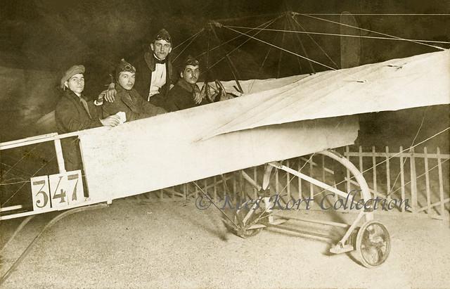 Four men posing before the camera in a familiar monoplane [France, pre-WW1]