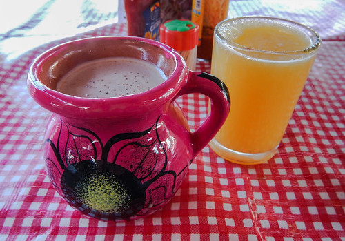 Drinks of coffee and fresh-squeezed orange juice in the mercadito in Marquelia, Mexico