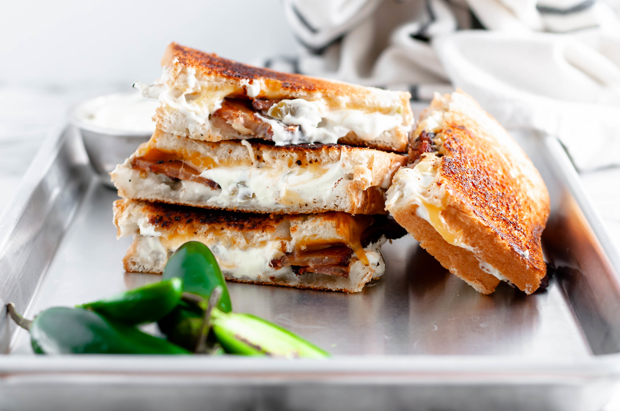 Meet your new favorite sandwich, the Jalapeno Grilled Cheese. Jalapeno jelly, cream cheese, pickled jalapenos, sharp cheddar and bacon combine to make the most glorious sandwich around.