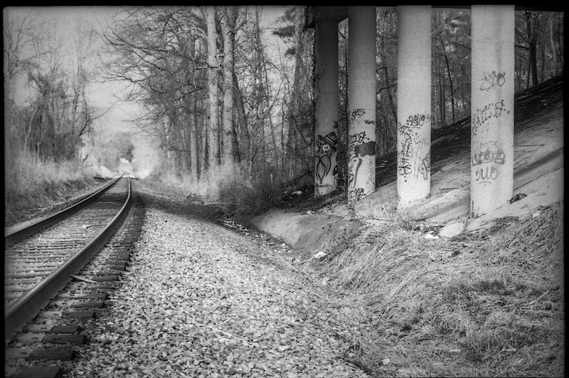 beneath an overpass II, railroad track, columns, graffiti, Smkokey Park Highway, Asheville, NC, Pentax Spotomatic, Super Takumar 50mm f-1.4, FPP Derev Pan 200, HC-110 developer, early February 2020
