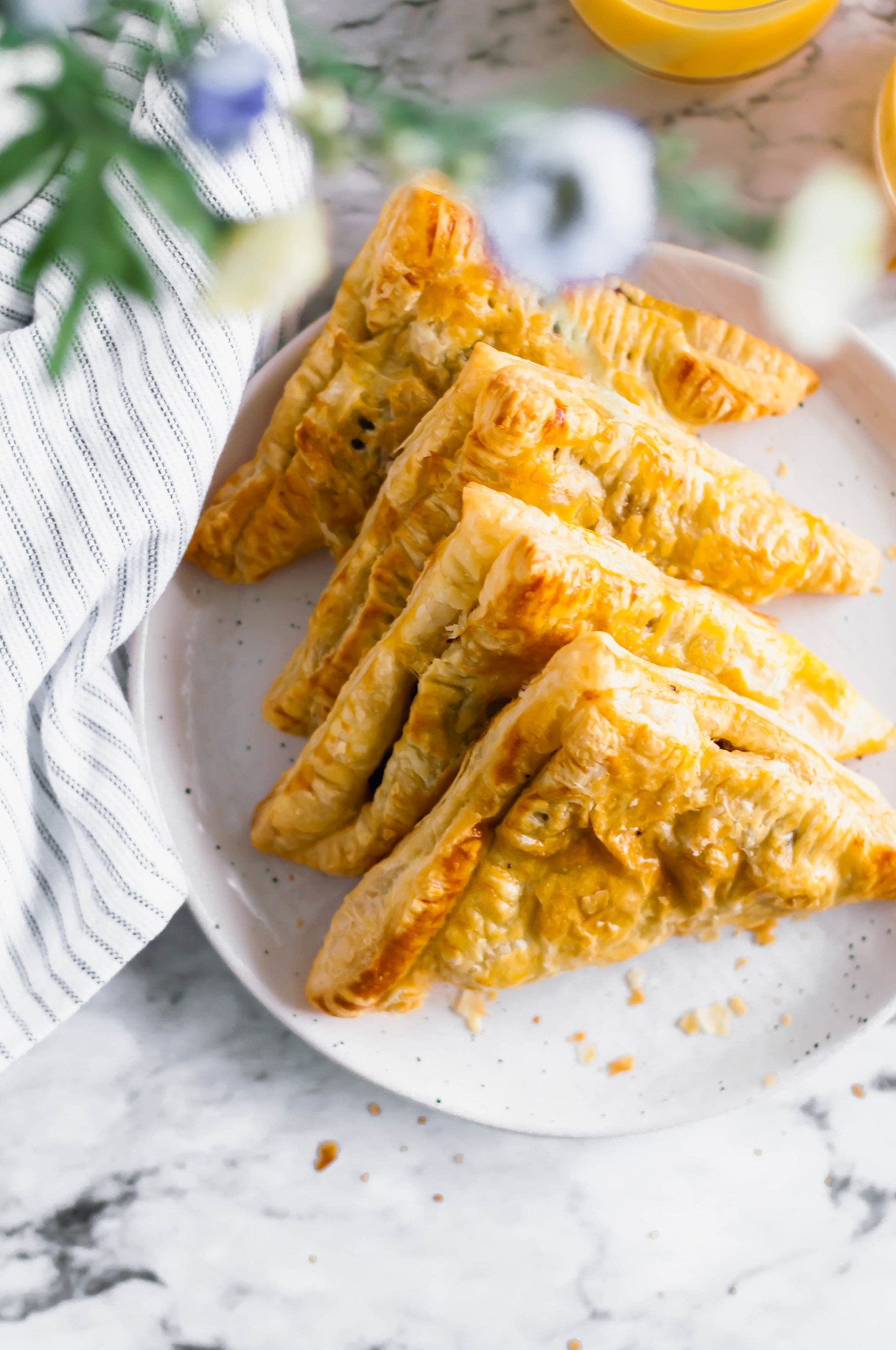 These Savory Turnovers are going to turn into your favorite brunch item. Flaky puff pastry filled with tender scrambled eggs, breakfast sausage and shredded sharp cheddar.