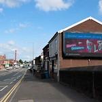 Illuminated roadside advert sign in Preston