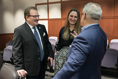 State Reps. Tony D'Amelio and Stephanie Cummings talk with Armando Paolino after a meeting of the Waterbury Rail Line Caucus.