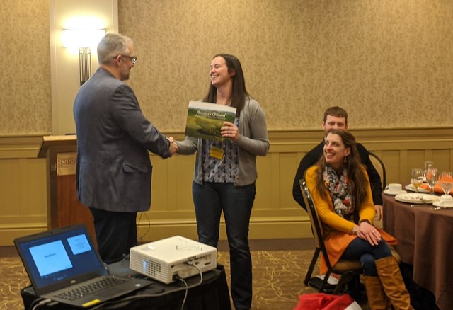 Sarah Zost, YGA co-chair, thanks Dr. Hales for his Lunch & Learn presentation