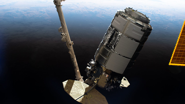 Cygnus cargo craft in the grips of the Canadarm2 robotic arm