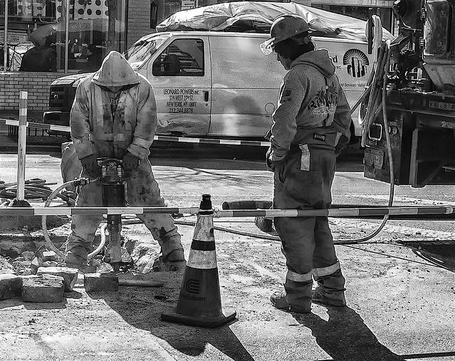 Men Hard At Work Repairing Roadway in NYC Olympus E-M5 LUMIX G 14/F2.5 ƒ/8.0  14.0mm 1/800  ISO800