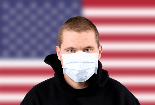 Man wearing protection face mask with flag of USA | by wuestenigel