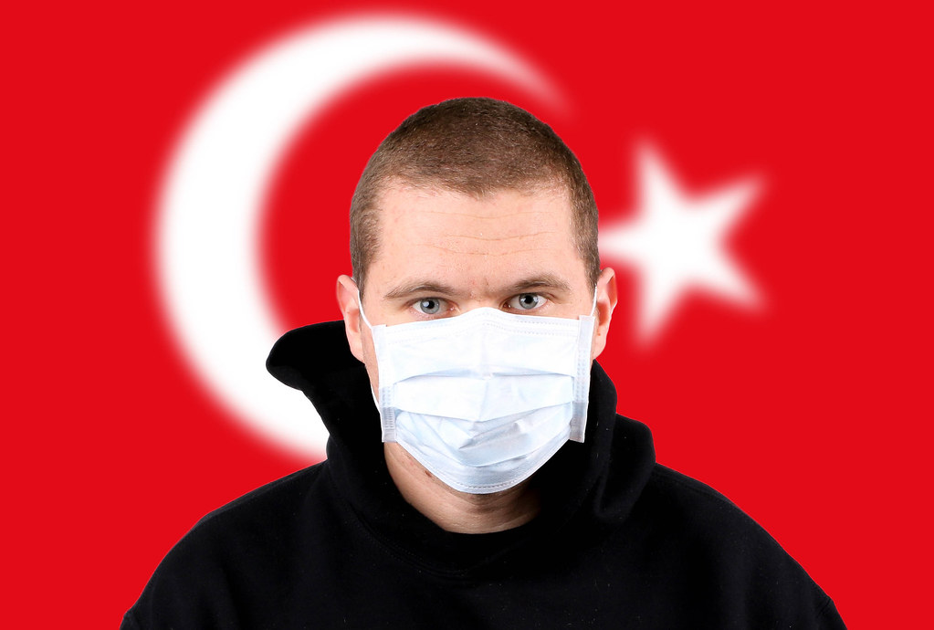 Man wearing protection face mask with flag of Turkey