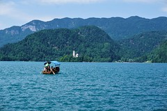 Traditional Pletna boat on it's way to Bled Island