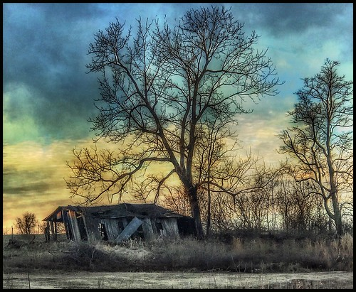 silhouettes sunset ruins dilapidated shed countryside rural ozarks missouri