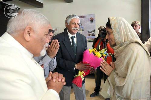 Her Holiness being presented a bouquet by RS Manhas Ji, President of the College
