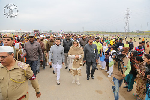 Her Holiness and Ramit Ji taking a round in the Ground