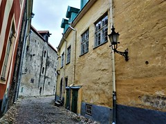 Beautiful old cobblestone street with colorful houses in Tallinn