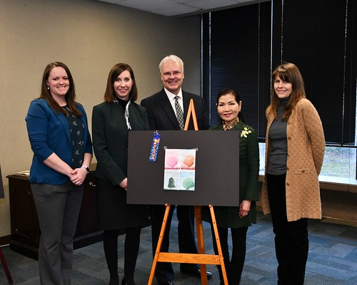 Photo of Tree-Mendous Maryland Coordinator Anne Gilbert; Secretary Jeannie Haddaway-Riccio,  Acting State Forester Kenneth Jolly; First Lady Yumi Hogan; and Urban and Community Forestry Supervisor Marian Honeczy stand with the winning entry in the 2020 Arbor Day poster contest.