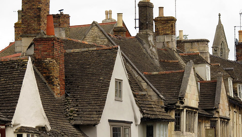 Slate roofs and chimneys overtop of stone houses in Stamford, England