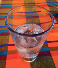 Taxco sparkling water served in a glass on a bright Mexican tablecloth in Zihuatanejo, Mexico