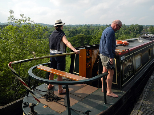 Canal boat making its way down the narrow canal on top of the Pontcysylite Aqueduct in Wales
