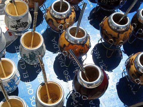 A flea market with a bunch of silver-rimmed gourd used as a cup for mate, the famous Argentinean tea