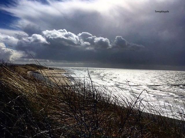Sun in the back and rainclouds comes from the sea, this gives a magic silver sea, photo taken in Westkapelle, Zeeland, Netherlands