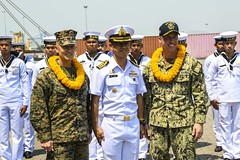 Col. Robert Brodie, left, 31st MEU commanding officer, and Capt. Luke Frost, right, commanding officer of USS America (LHA 6) are welcomed by Royal Thai Navy Capt. Arpa Chapanon after the amphibious assault ship's arrival, Feb. 22. (U.S. Navy/MC3 Vance Hand)