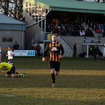 Kai Ross turns away to celebrate after making it three-nil