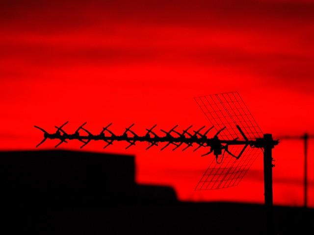 Red antennas at sunset