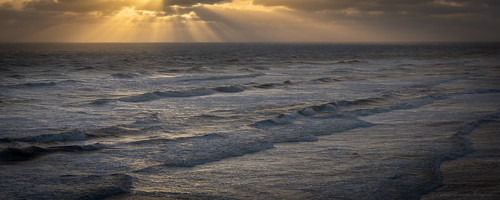 daytona beach sunrise clouds light rays atlantic ocean fl florida usa surf waves