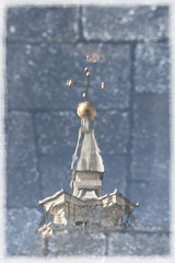 Bandstand weather vane puddle reflection
