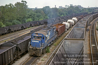 Alco C425 2426 is seen splitting an ore train & Detroit Edison unit train with molten metal bottles in September of 1979 at Youngstown, Ohio.