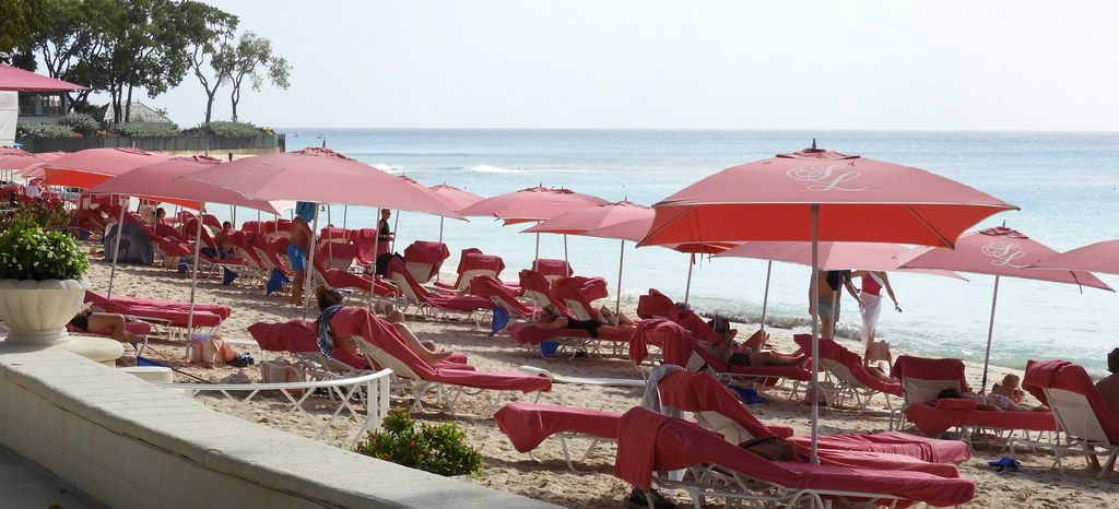 Pink beach towels, pink umbrellas and pink chaise lounges at Sandy Beach, Barbados
