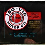 Wed, 2020-01-22 20:36 - 1920s-era glass slide from a Standard Oil (Indiana) agent in Davenport, ND named E. H. Johnson, advertising Iso-Vis motor oil. Likely a one-of-a-kind piece. These slides were projected on screens in movie theaters to promote local merchants before the silent movie began.