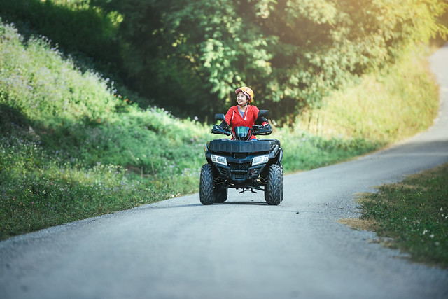 A trip on the ATV on the red road.A trip on the ATV on the road.