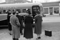 Passengers wait to load onto the Shore Line bus 065loccol